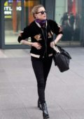 Amber Heard looks casually fashionable as she arrives at Heathrow airport in London, UK