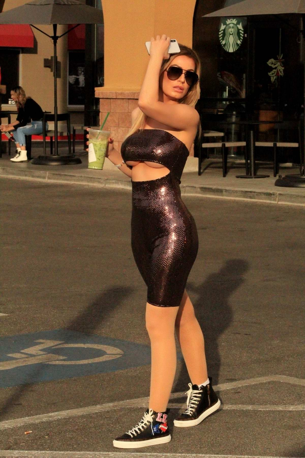 Ana Braga wears a sparkly purple bodysuit while out for some healthy smoothie at Starbucks in Los Angeles
