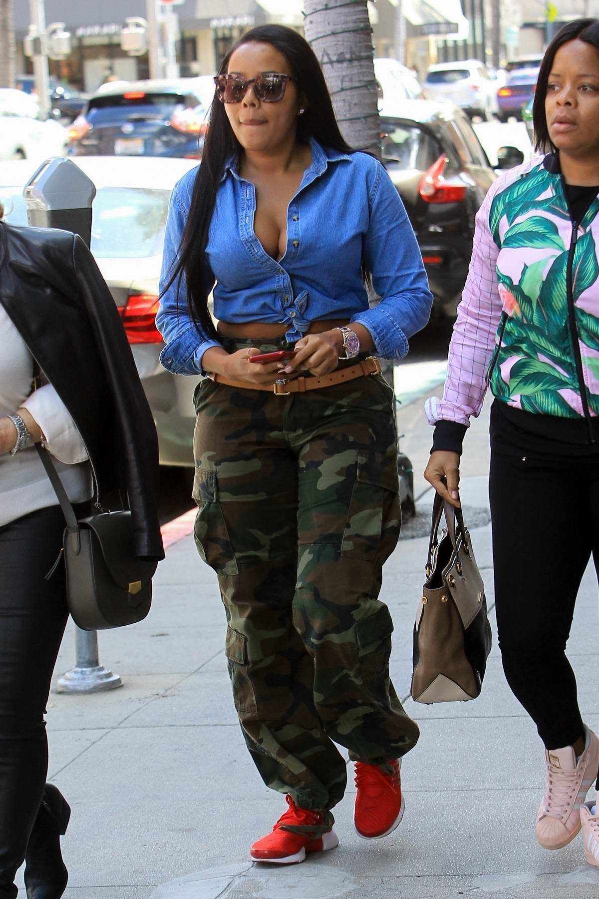 Angela Simmons runs errands in knotted denim shirt and camo pants in Beverly Hills, Los Angeles