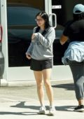 Ariel Winter seen wearing grey sweatshirt and black gym shorts as she leaves the studio with a friend in Los Angeles