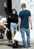 Ariel Winter wears a cropped black sweater and denim shorts while out for lunch with Levi Meaden at Joan's on Third in Studio City, Los Angeles