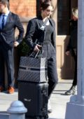 Bella Hadid seen leaving her apartment with her personalized luggage as she heads to the JFK airport in New York City