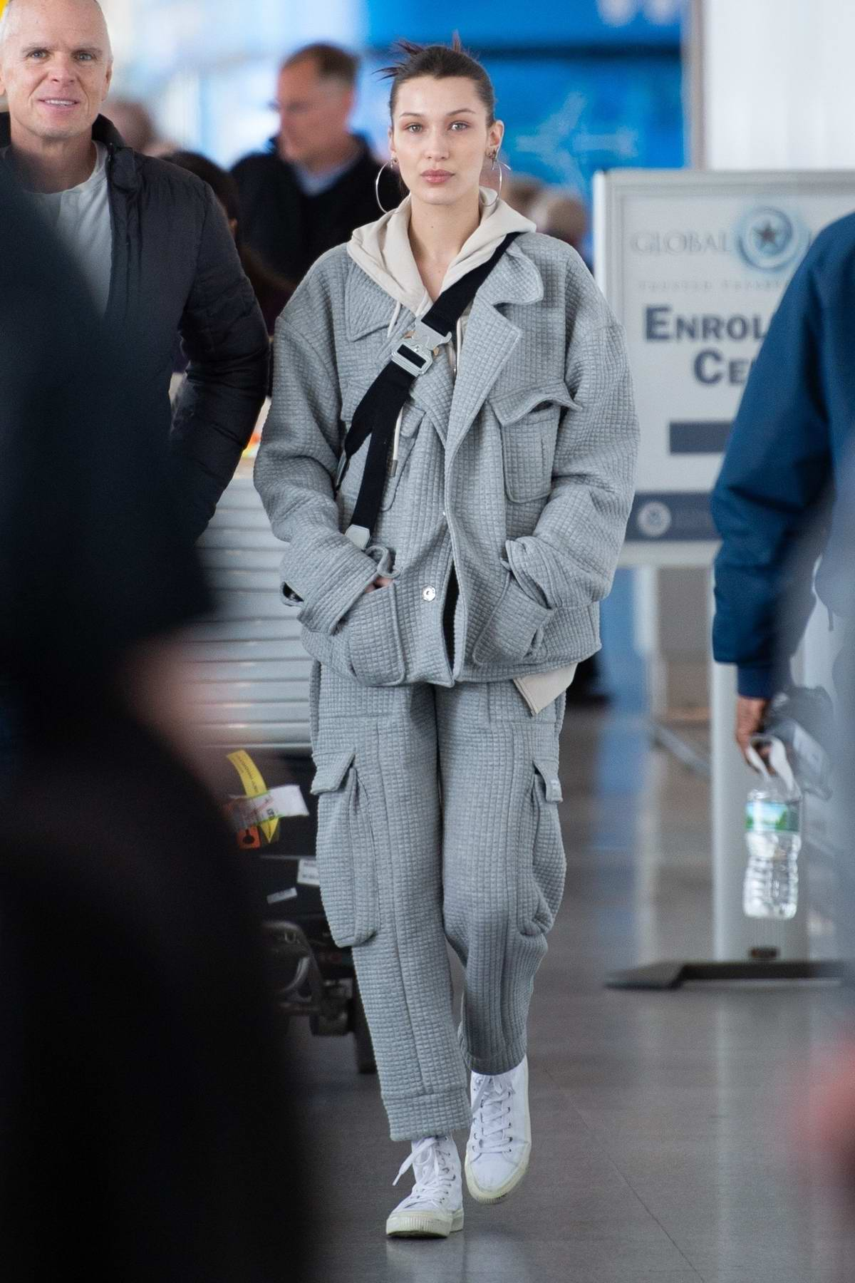 Bella Hadid sports a trendy look as she arrives at JFK airport in New York City