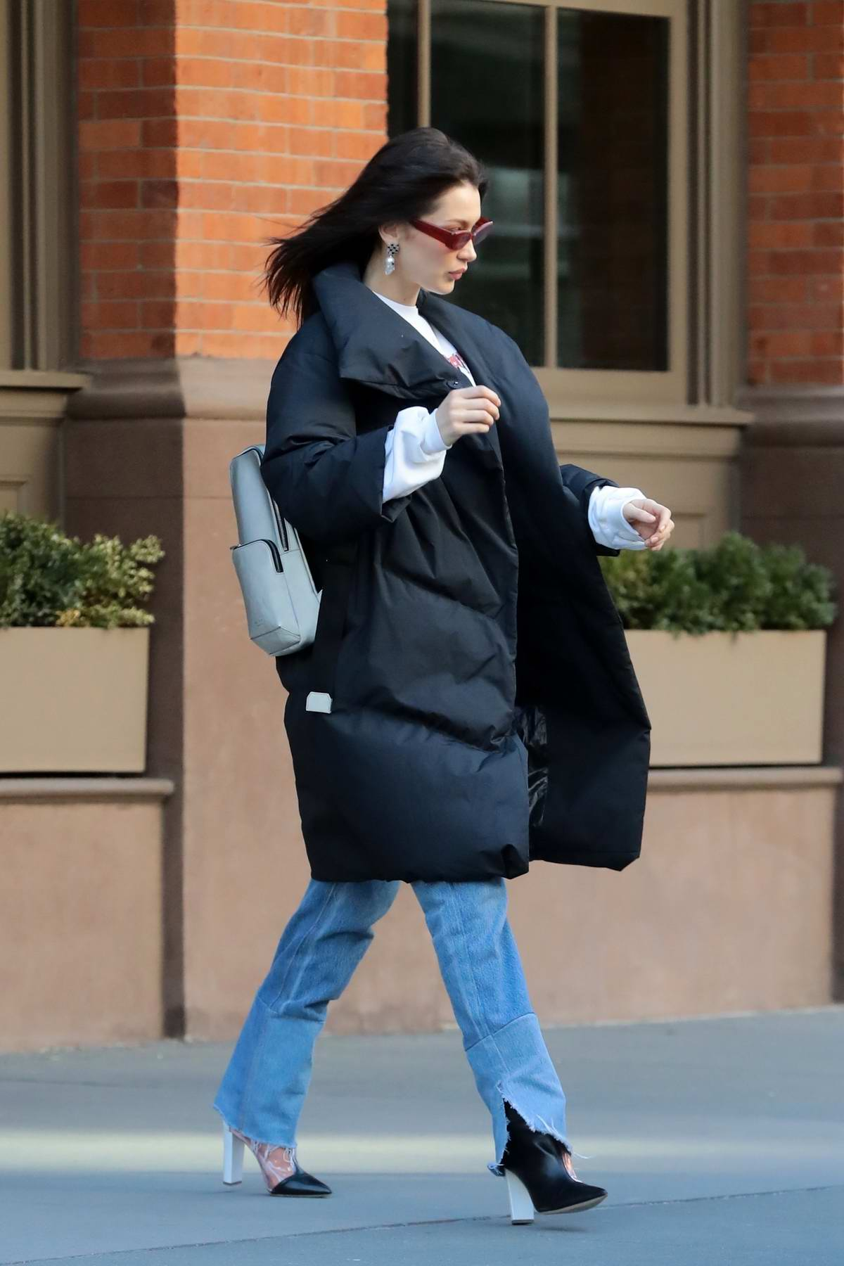Bella Hadid steps out in a black puffy jacket in New York City