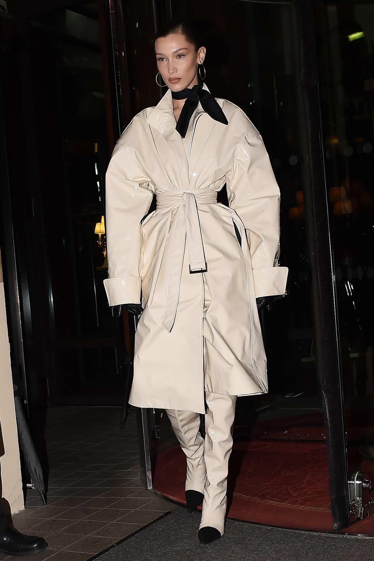 Bella Hadid wears an all beige ensemble as she heads to the Louis Vuitton party in Paris, France