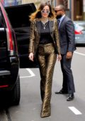 Bella Thorne steps out in a tiger print gold suit in New York City