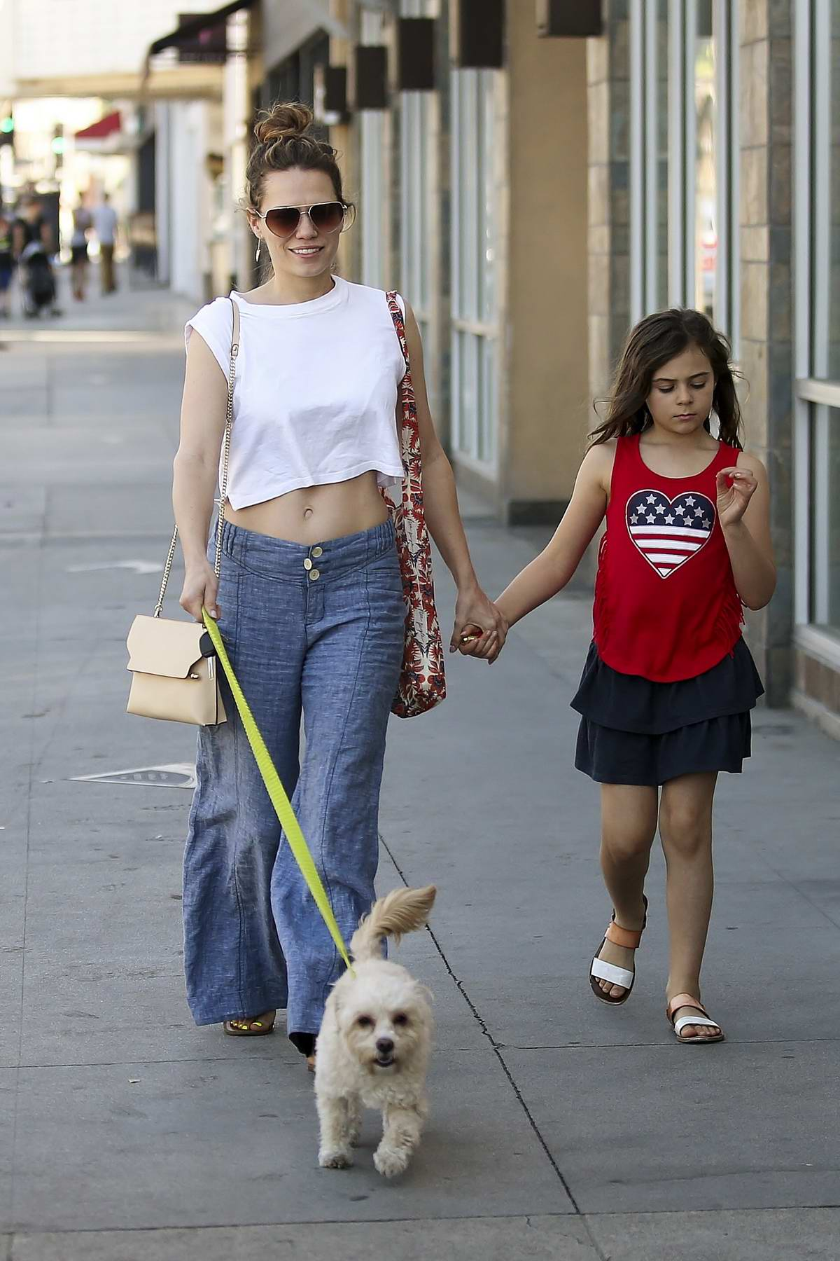 Bethany Joy Lenz steps out with her daughter to walk her dog in Los Angeles