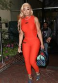 Blac Chyna stands out in a red bodysuit as she stops by the Sunset Marquis Hotel in West Hollywood, Los Angeles