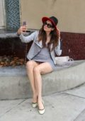Blanca Blanco poses for photos and selfies in a short grey dress while out for lunch in Beverly Hills, Los Angeles