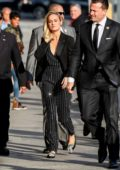 Brie Larson seen wearing a black pinstriped jumpsuit with a black blazer as she arrives for an appearance on Jimmy Kimmel Live! in Los Angeles