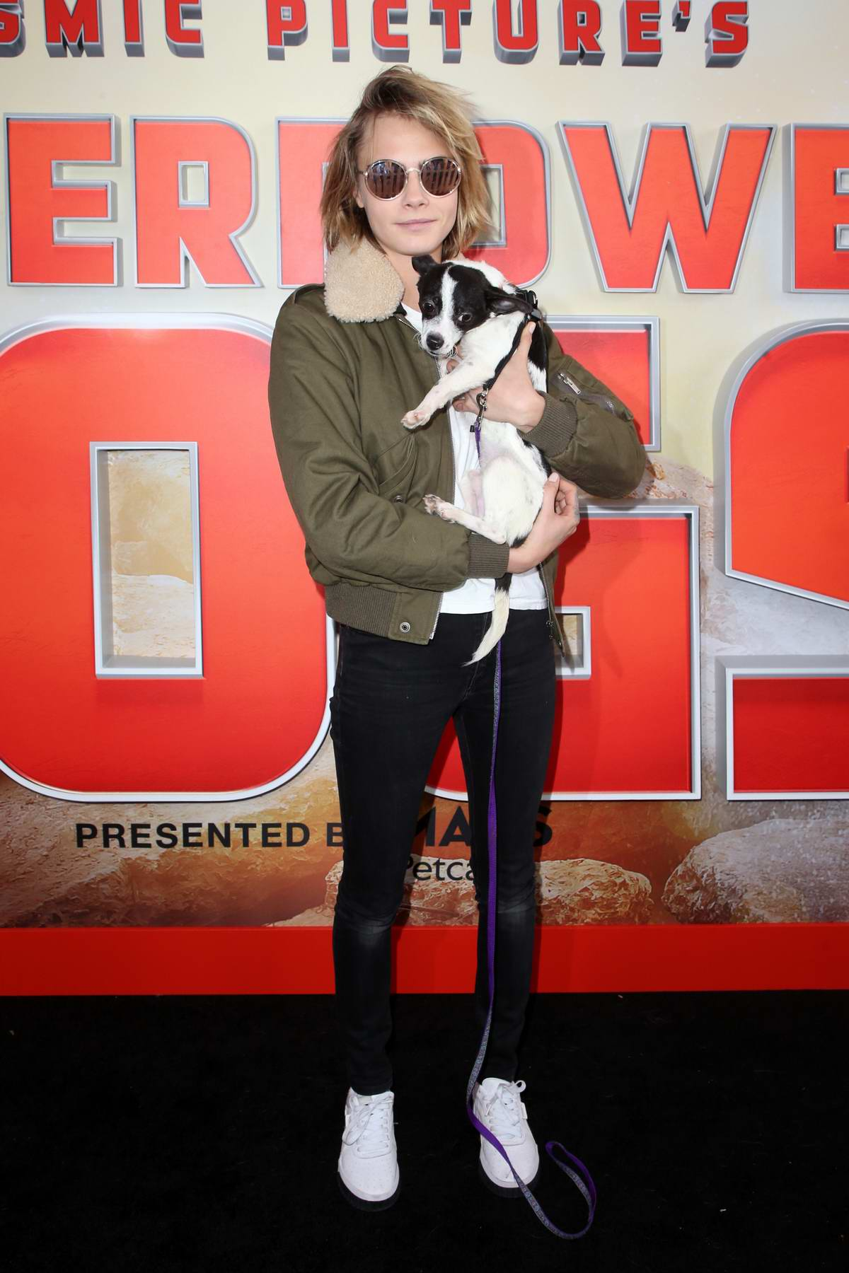 Cara Delevingne attends 'Superpower Dogs' film premiere at the California Science Center in Los Angeles