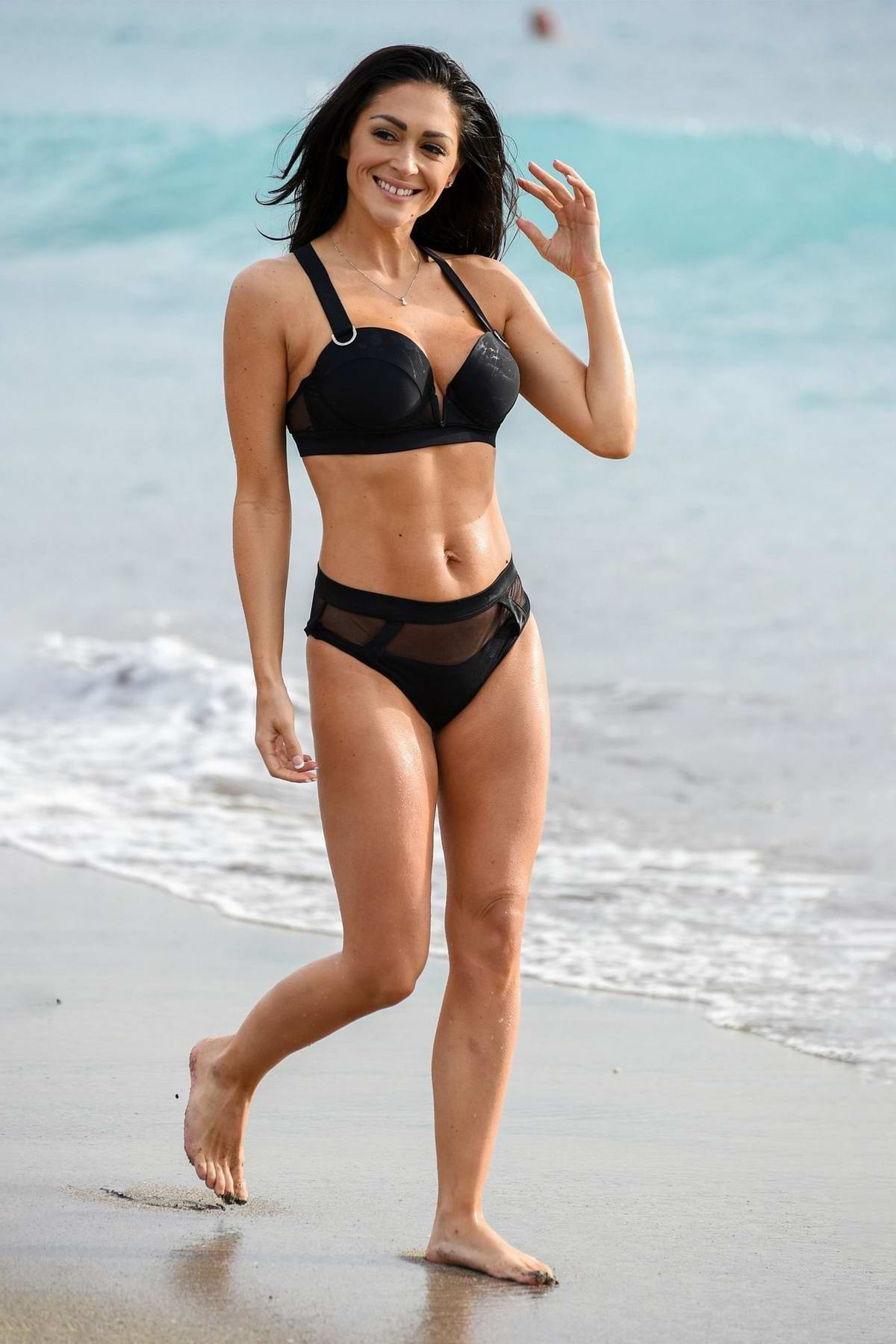 Casey Batchelor dons a black bikini while filming for her yoga app 'Yoga Blitz' in Tenerife, Spain