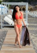 Casey Batchelor relaxes on the beach in an orange bikini while on holiday in Tenerife, Spain