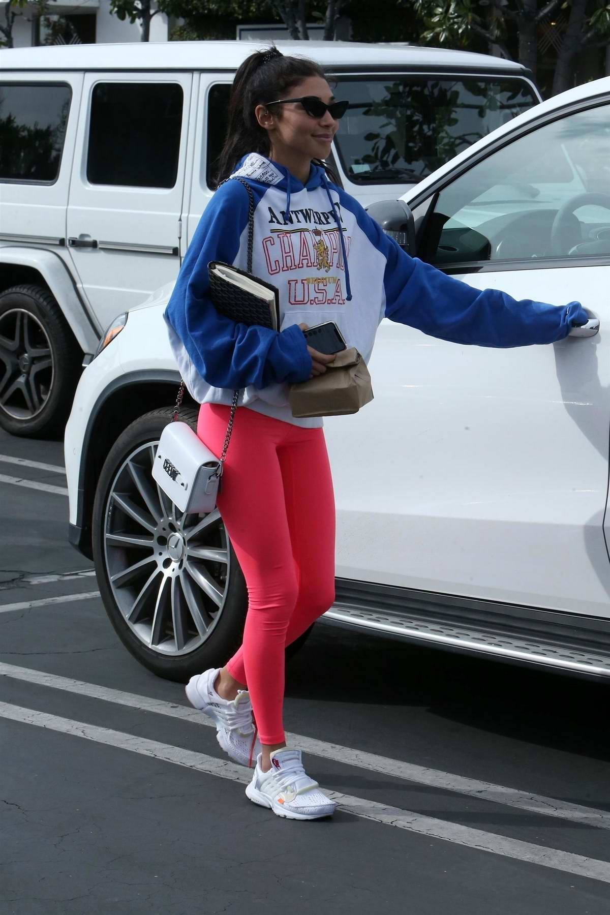 Chantel Jeffries rocks a blue and white hoodie, pink leggings and Nike Air Jordans while out to lunch at Mauro's Cafe Fred Segal in West Hollywood, Los Angeles