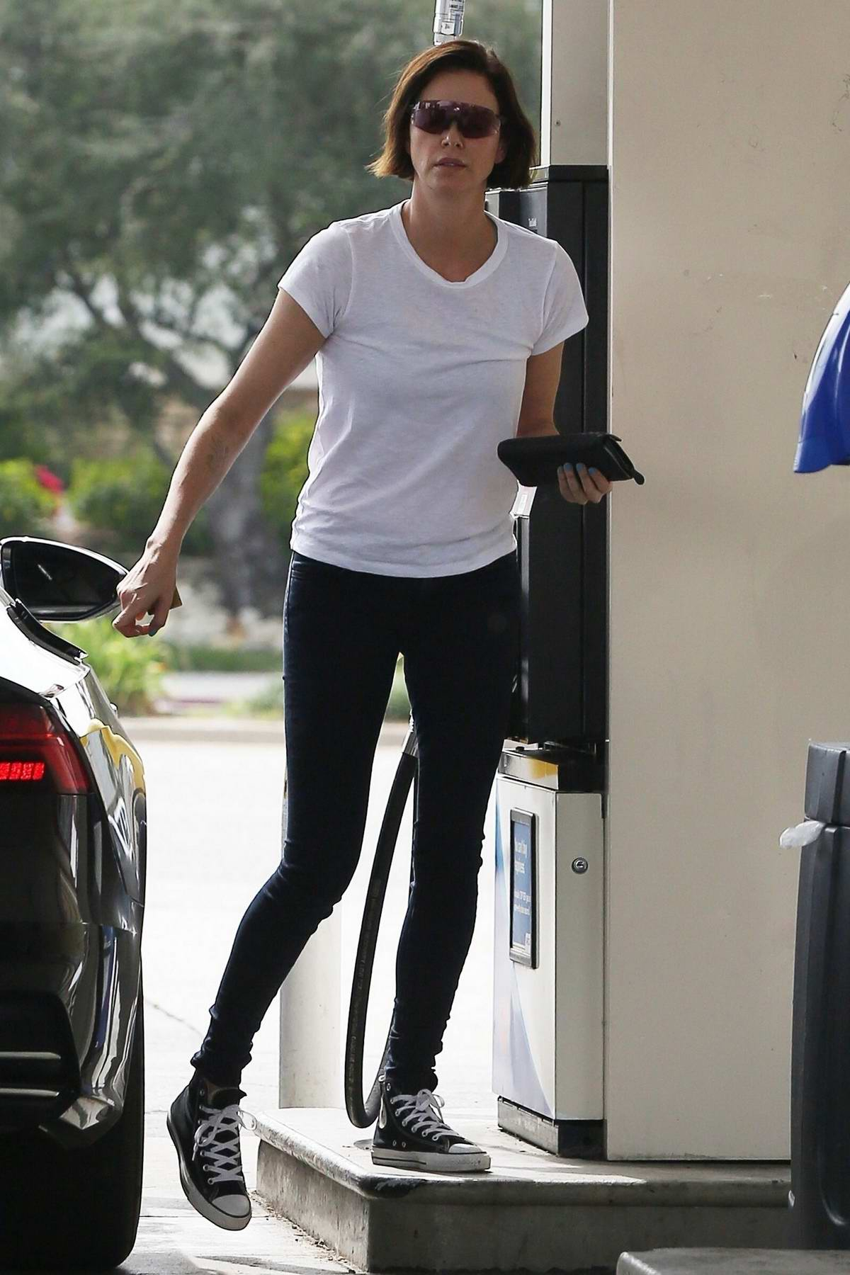 Charlize Theron keeps it casual in a white tee and jeans as she stops by a gas station in Los Angeles