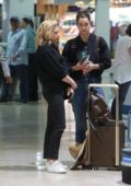 Chloe Grace Moretz and Kate Harrison take selfies with fans at the airport in Puerto Vallarta, Mexico