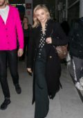 Chloe Grace Moretz spotted in all black with her Louis Vuitton bags as she arrives at the CDG Airport in Paris, France