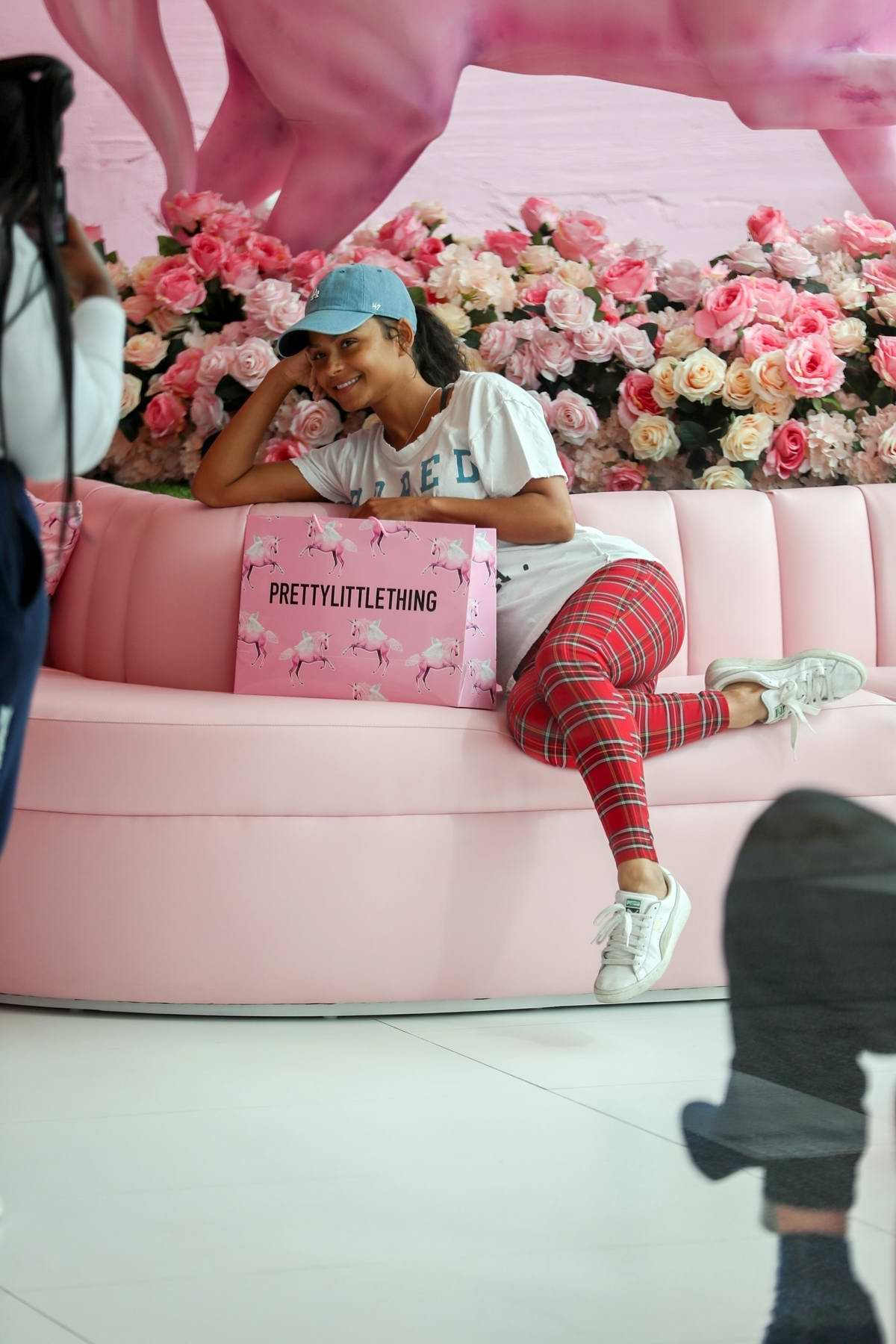 Christina Milian pose for photos while shopping at PrettyLittleThing in West Hollywood, Los Angeles