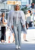 CJ 'Lana' Perry wears a sheer white top paired with a white fur coat while out in Hollywood, California