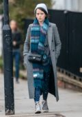 Claire Foy keeps warm with a checkered long coat with a knit beanie and woolen scarf as she leaves Bodyism in Notting Hill, London, UK
