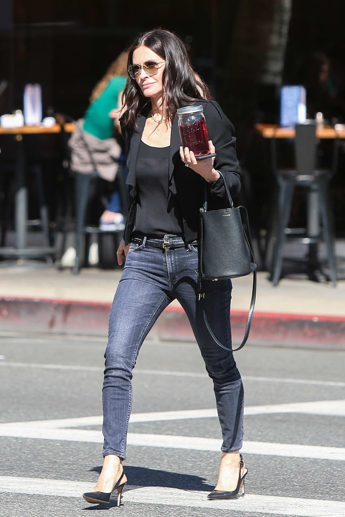 Courteney Cox is looking extra slim and fit as she crosses the street after attending a business meeting in Beverly Hills, Los Angeles