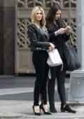 Delta Goodrem looks stunning in an all black ensemble while out with friend in New York City