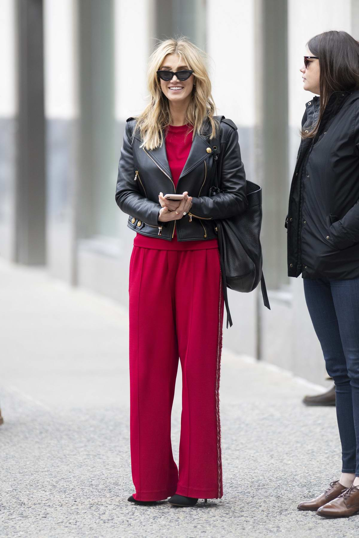 delta goodrem steps out in an eye-catching red outfit on ...