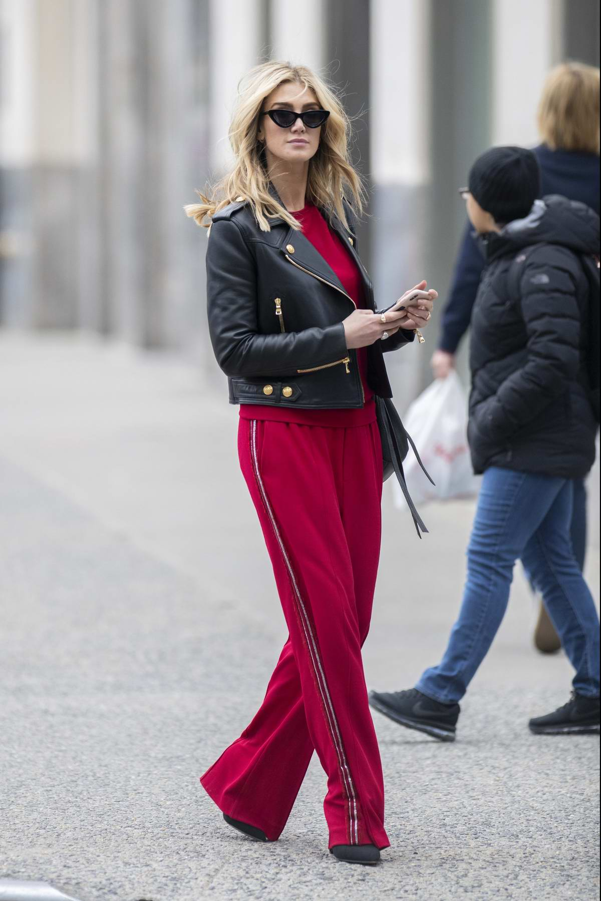 Delta Goodrem steps out in an eye-catching red outfit on her way to lunch in New York City