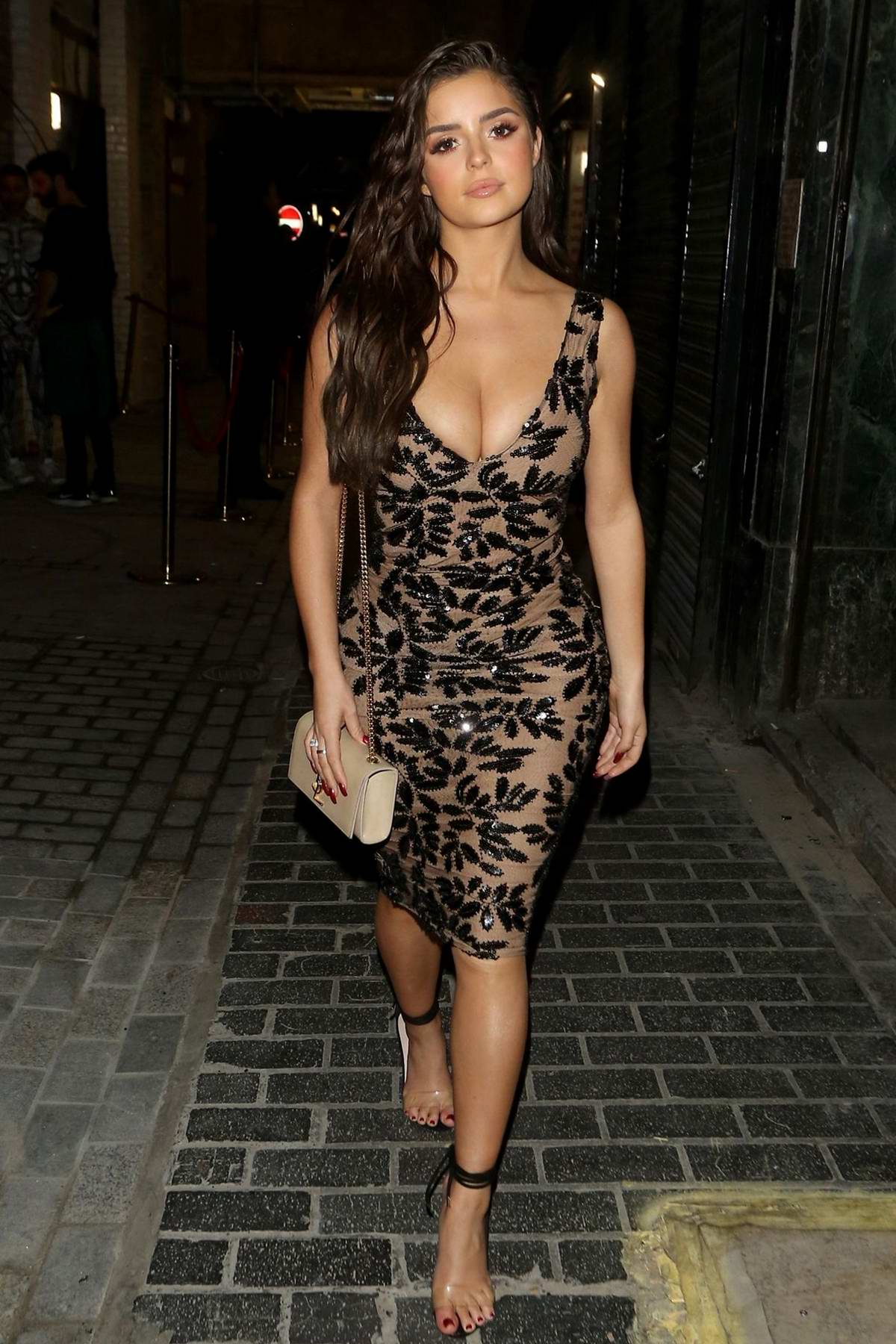 Demi Rose stuns in a form-fitting dress while out to celebrate her 24th birthday in London, UK