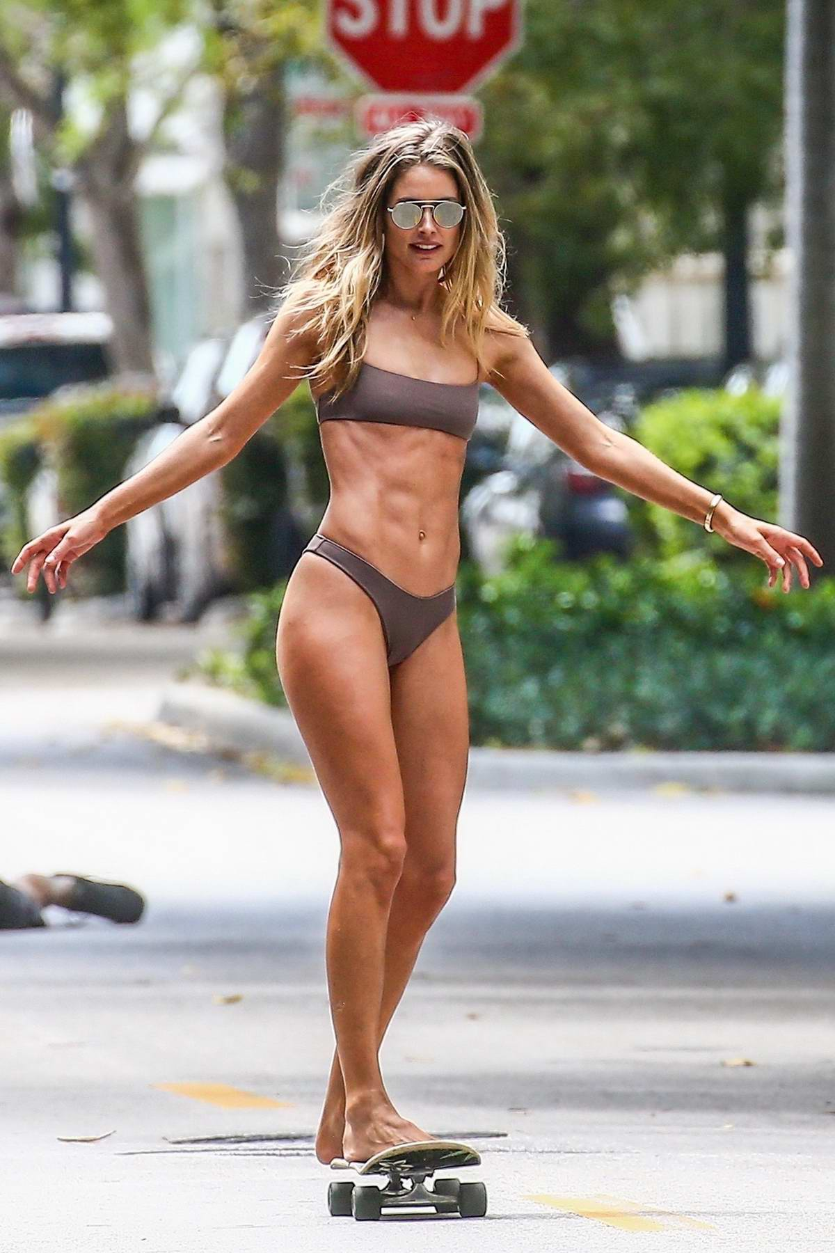 Doutzen Kroes looks incredible in a bikini while posing on a skateboard during a photo shoot in Miami, Florida