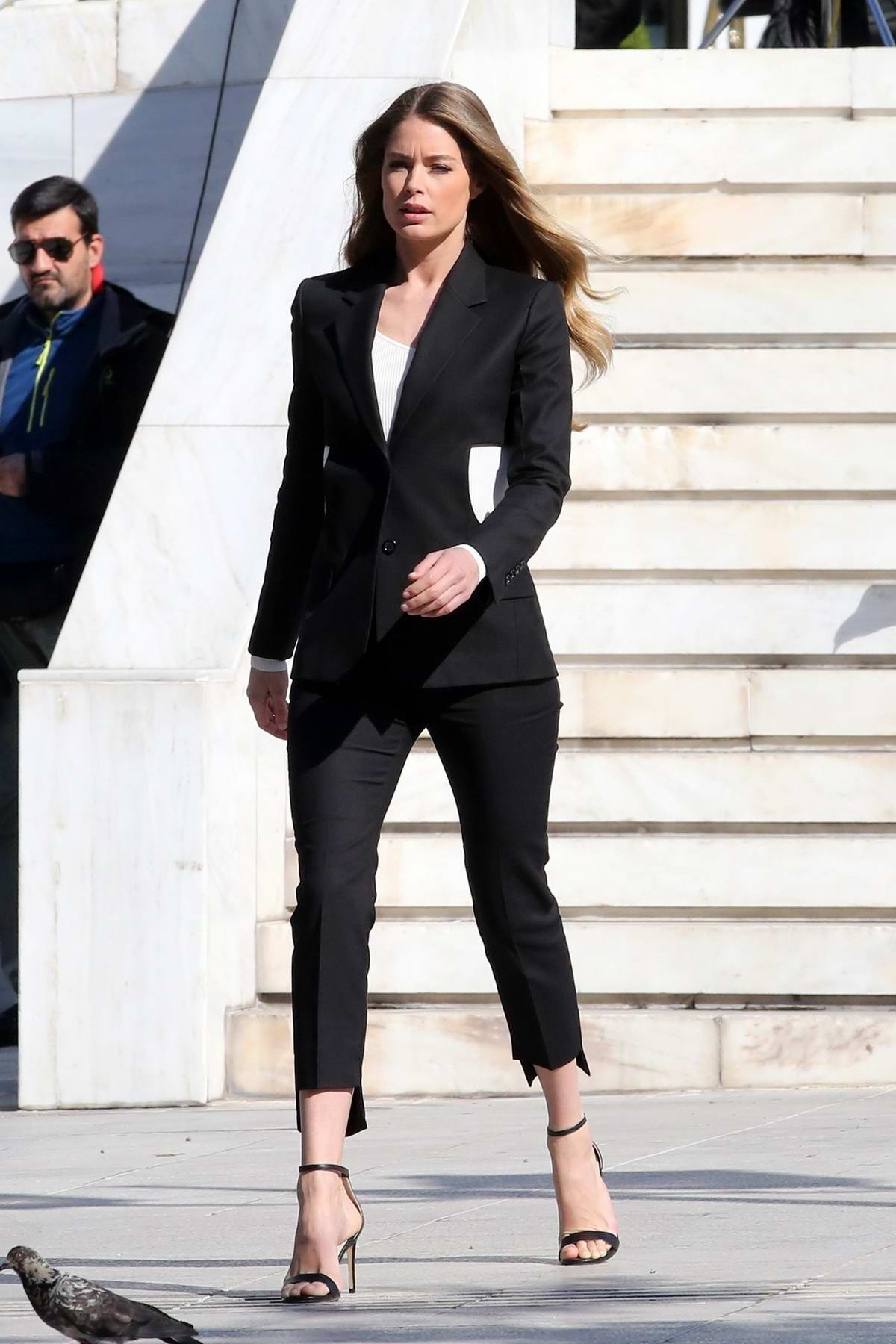 Doutzen Kroes poses in a black pantsuit during a L'Oreal photoshoot in Athens, Greece