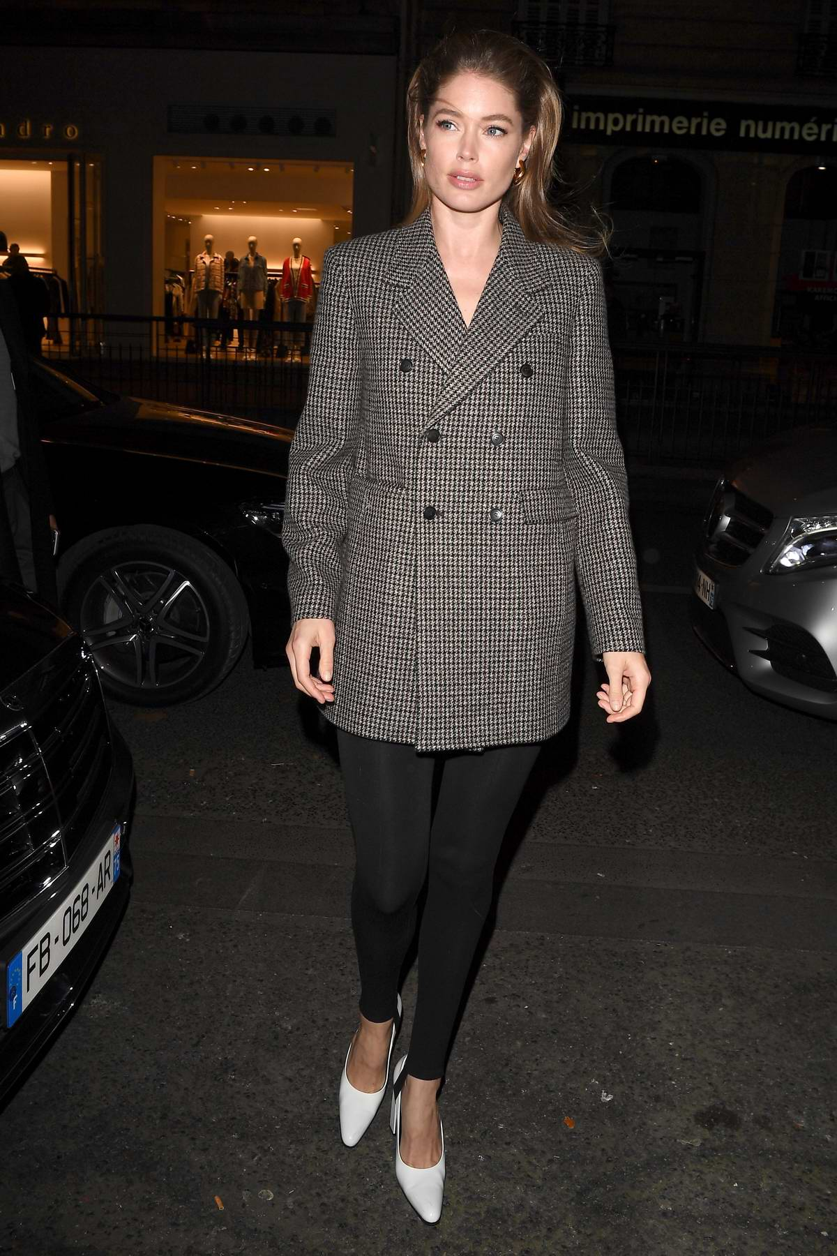 Doutzen Kroes steps out in a grey blazer and black leggings as she leaves her hotel in Paris, France