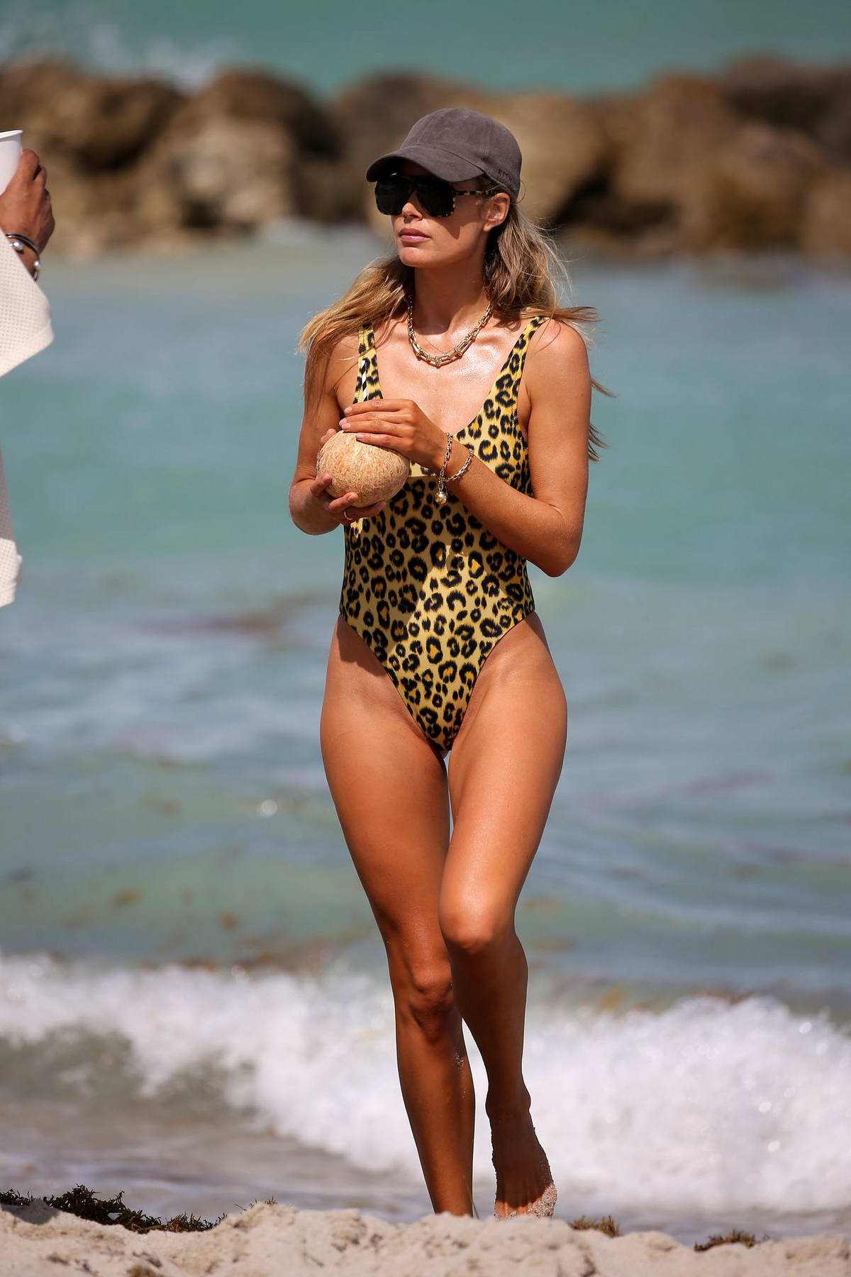 Doutzen Kroes stuns in a leopard print swimsuit during a beach day in Miami, Florida