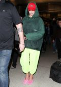 Dua Lipa tries to go incognito as she touches down at LAX Airport in Los Angeles
