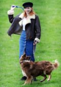 Eleanor Tomlinson enjoying some playtime out with her dog in the park in London, UK