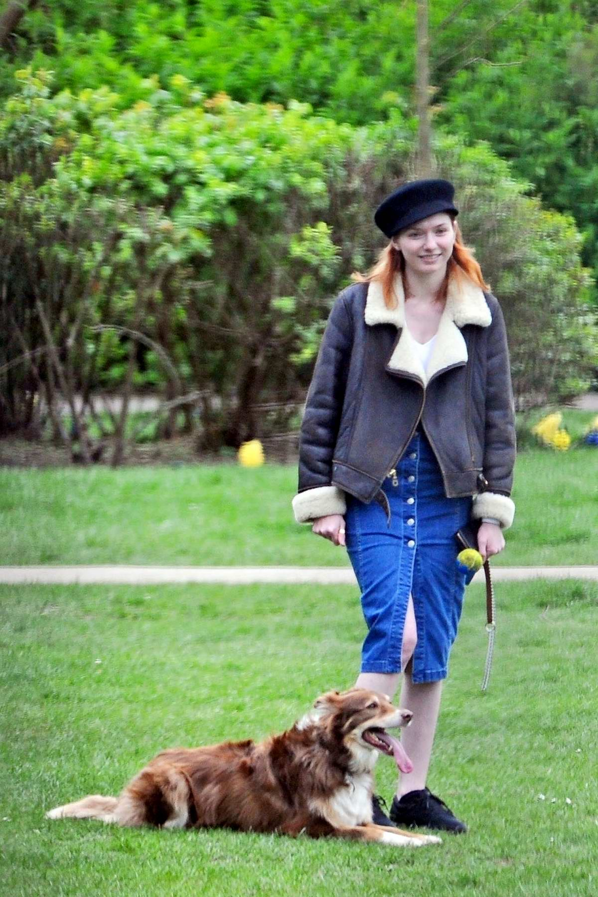 eleanor tomlinson enjoying some playtime out with her dog ...