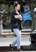 Elizabeth Olsen tucks into a healthy salad for lunch in Los Angeles