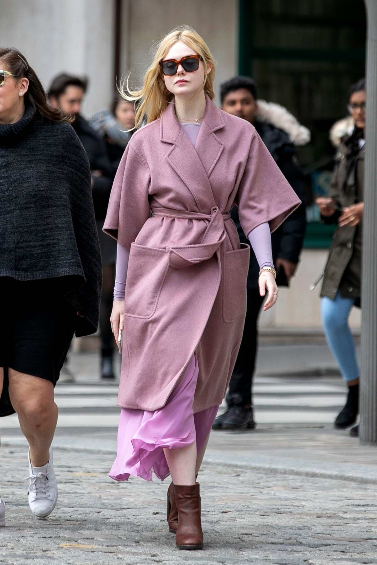 Elle Fanning looks stylish in a mauve coat with pink dress as she steps out during Paris Fashion Week F/W 2019 in Paris, France