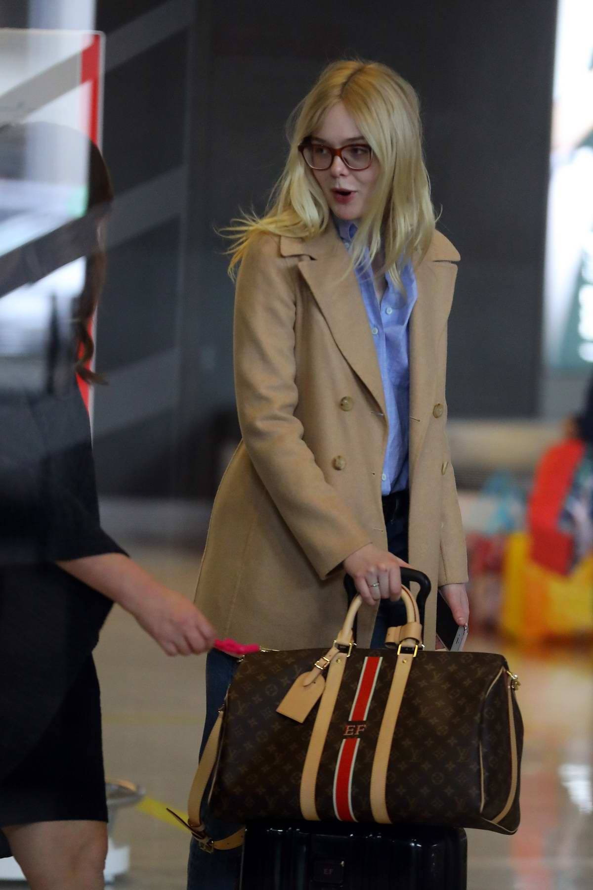 1ce1aea545f1e4 elle fanning sports gucci glasses paired with a tan blazer, blue ...