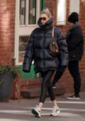 Elsa Hosk bundles up in a black puffer jacket and leggings while out in Soho, New York City