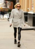 Elsa Hosk seen wearing a grey blazer with a black leggings while out and about in New York City