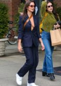 Emily Ratajkowski looks trendy in a blue robe style blazer with matching trousers while out for a stroll in New York City