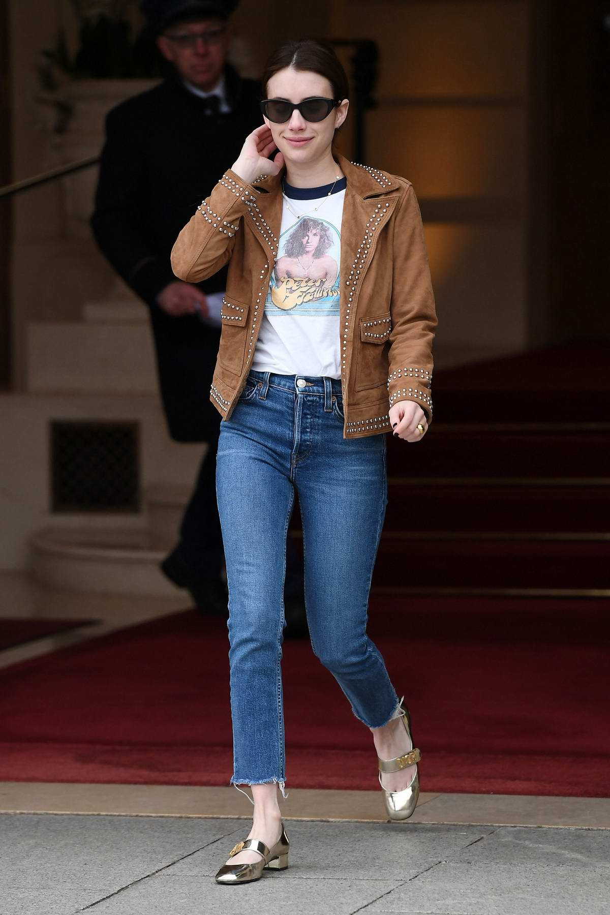 Emma Roberts looks lovely in a brown jacket and blue jeans as she leaves the Ritz Hotel in Paris, France