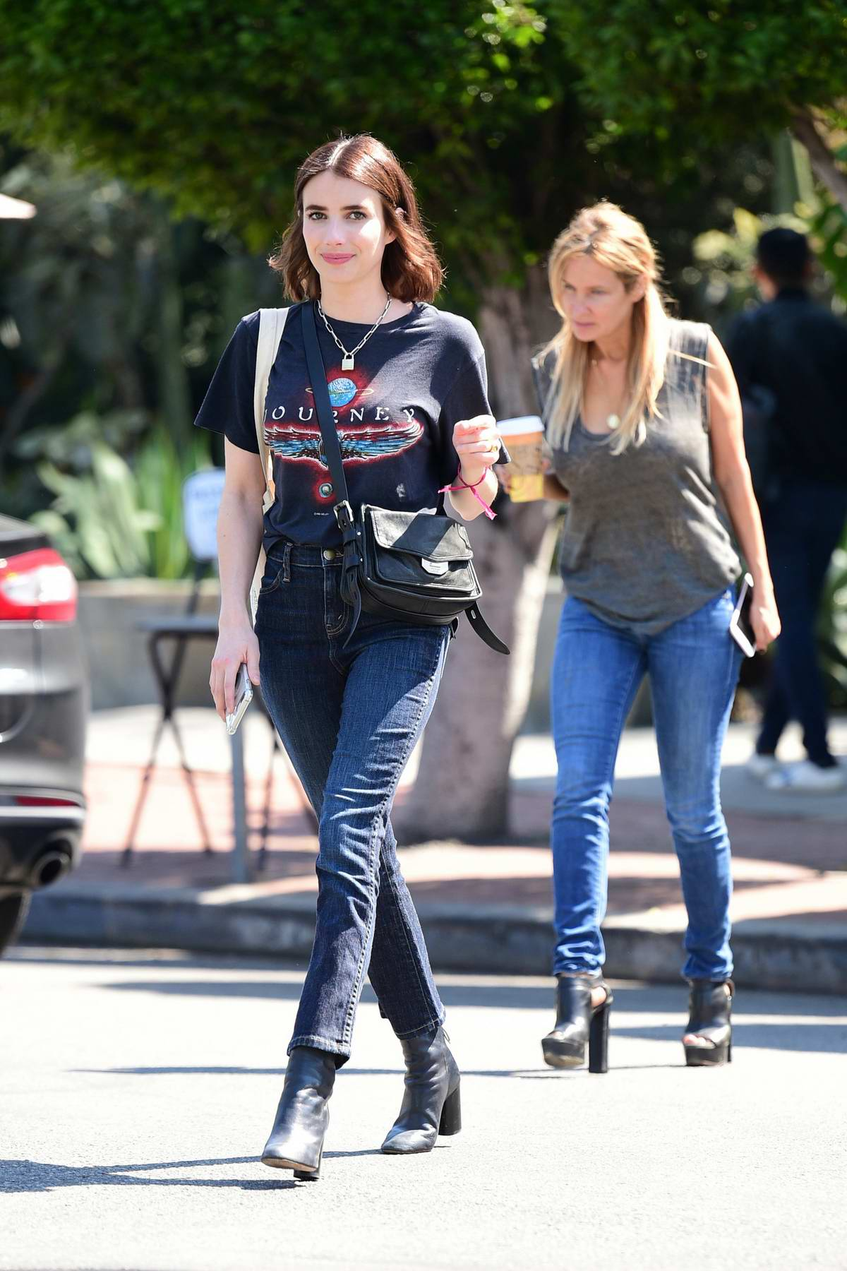 Emma Roberts smiles for the camera as she steps out in a blue tee and jeans in Los Angeles