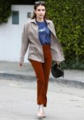 Emma Roberts sports a retro look in a plaid shirt, blue tee and corduroy pants while out running errands in Los Angeles