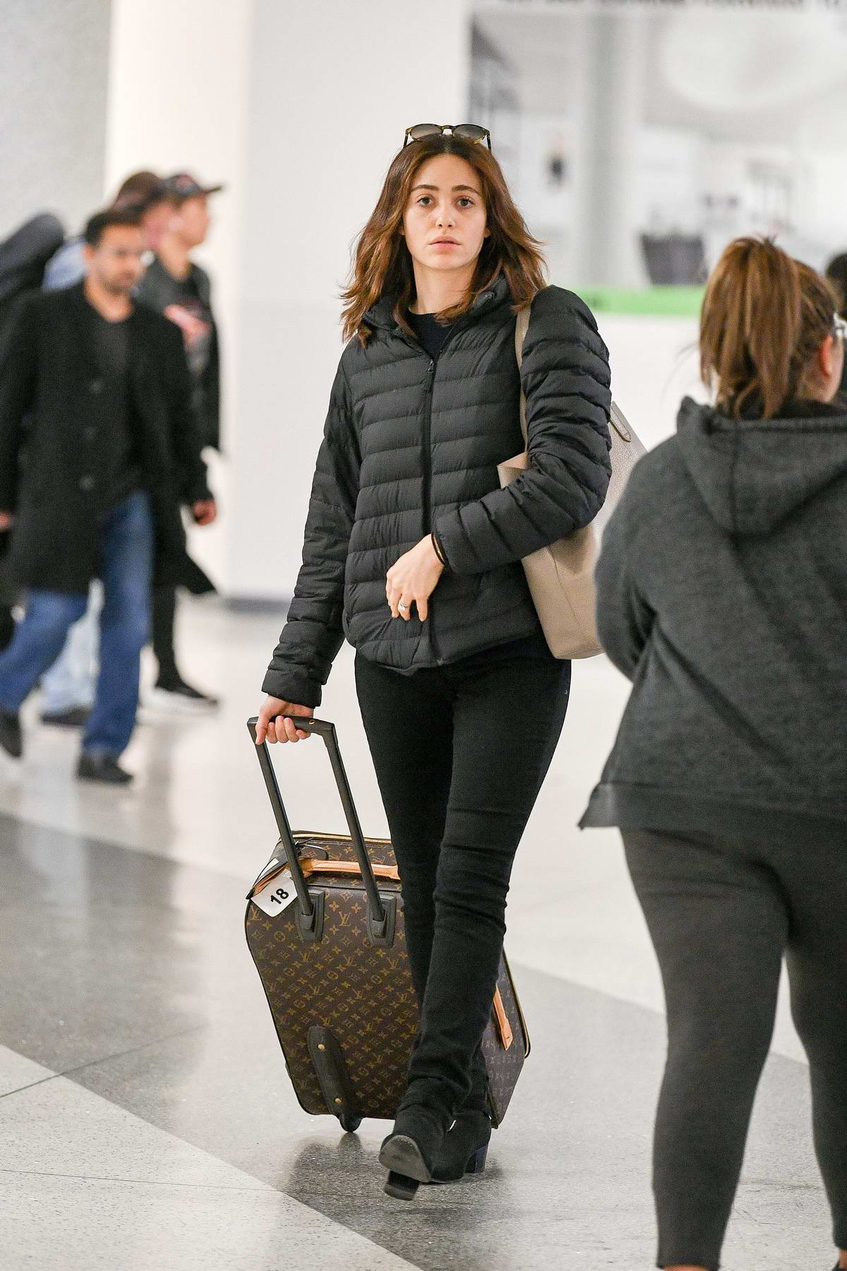 Emmy Rossum dons all black as she touches down at LAX airport in Los Angeles