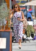 Eva Mendes is all smiles as she heads out shopping in a printed jumpsuit in Los Angeles