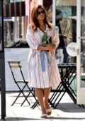 Eva Mendes wears a striped dress while out running errands in Los Angeles