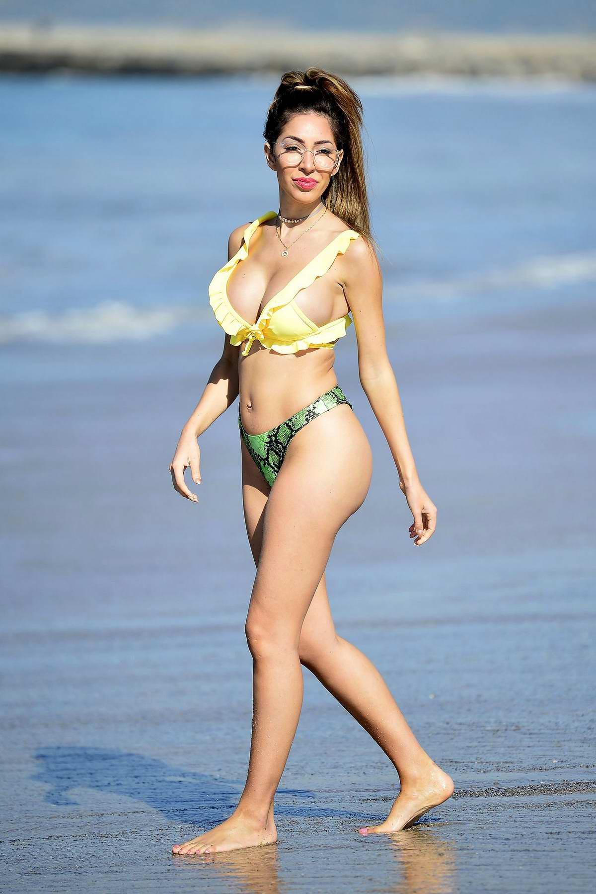 Farrah Abraham poses in a colorful bikini for a PrettyLittleThing photoshoot at the beach in Malibu, California
