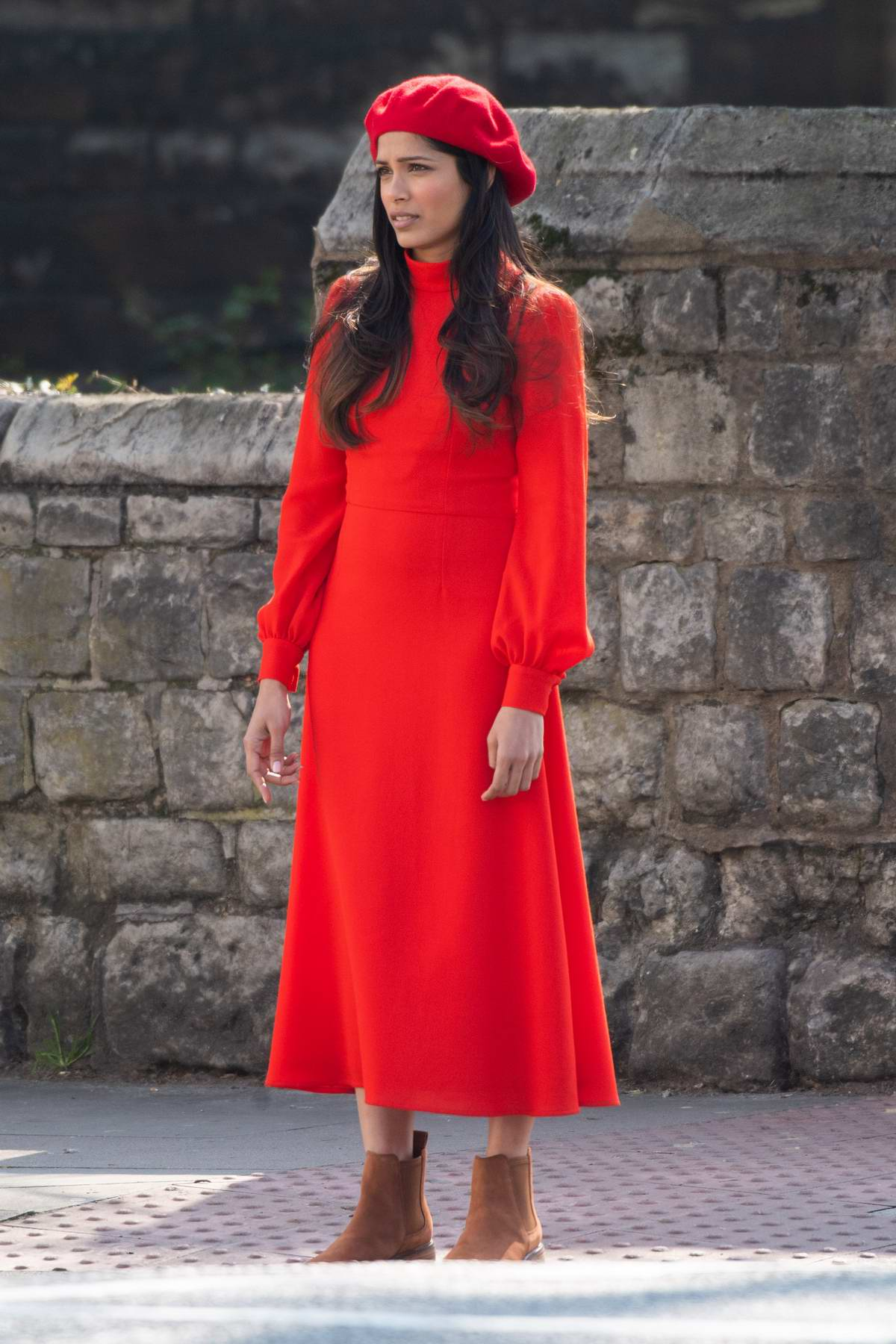 Freida Pinto stands out in red during a film shoot in Primrose Hill, London, UK
